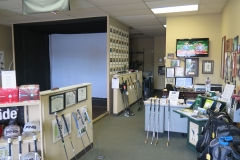 View of Golf Rx's Full Swing Golf Simulator and store